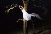 From the series Keep Her Unnoticed, dancer in tree at night