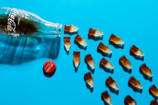 Cola sweets falling out of a Coke bottle